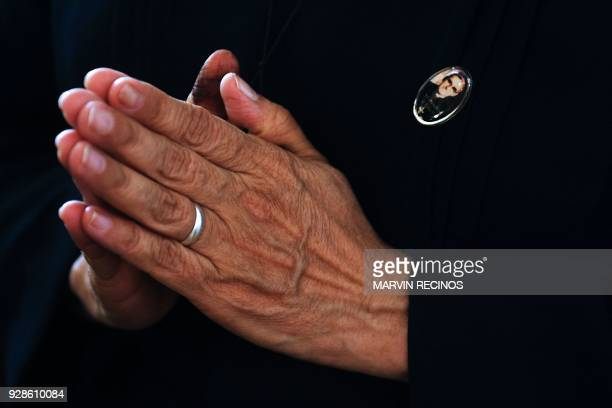 A Catholic faithful prays during a mass to celebrate the announcement that Pope Francis signed decrees allowing the canonization of Pope Paul VI and...