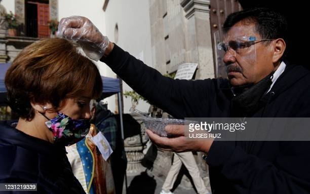 Catholic faithful receives ashes on Ash Wednesday, the first day of Lent, in Guadalajara state of Jalisco, Mexico, on February 17, 2021.