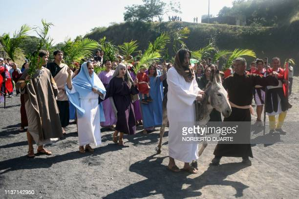 Catholic faithful take part in the reenactment of Jesus Christ's entry into Jerusalem during the Palm Sunday procession in Cerro Nemby in the...