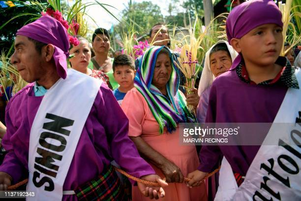 Catholic faithful take part in the traditional Palm Sunday procession in Panchimalco 18 km south of San Salvador on April 14 2019 For Christians Palm...