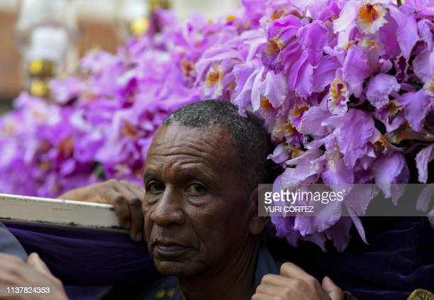 A Catholic faithful takes part in the traditional Nazareno de San Pablo procession in the framework of Holy Week celebrations in Caracas on April 17...