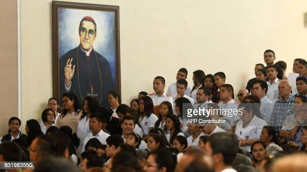 Catholic faithfuls attend a mass to mark the centenary of blessed Oscar Arnulfo Romero's birth in San Salvador on August 15 2017 Salvadoran...