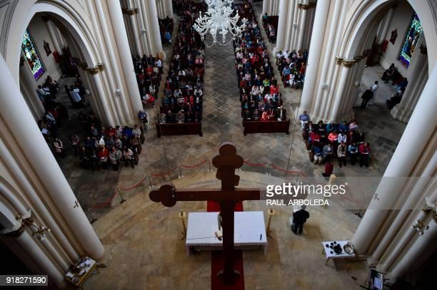 Catholic faithfuls attend the celebration of Ash Wednesday at Our Lady of Lourdes Sanctuary in Bogota on February 14 2018 Wednesday marks the...