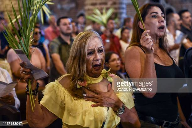 Catholic faithfuls attend the traditional Palm Sunday mass at the Metropolitan Cathedral in Medellin on April 14 2019 For Christians Palm Sunday...