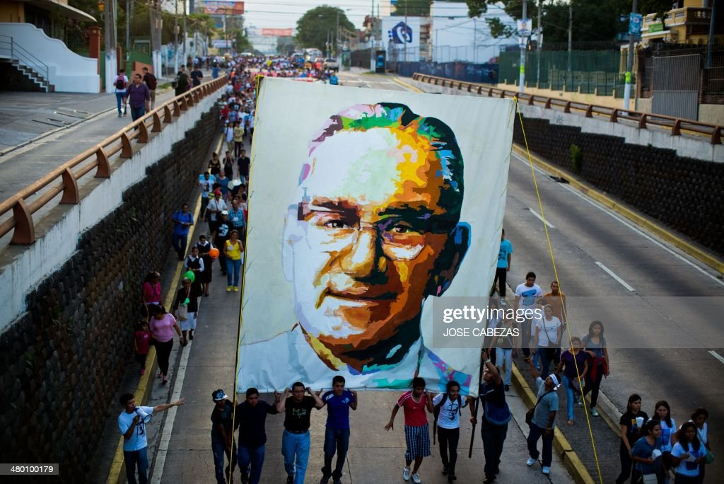 Catholic faithfuls march in San Salvador on March 22, 2014 during the commemoration of the 33th anniversary of the murder of Monsignor Oscar Arnulfo Romero, who was murdered when he was officiating the mass in 1980. AFP PHOTO/ Jose CABEZAS