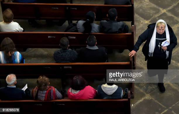 Catholic faithfuls participate in the celebration of Ash Wednesday at Our Lady of Lourdes Sanctuary in Bogota on February 14 2018 Wednesday marks the...