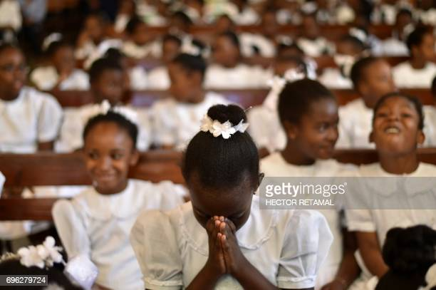 Catholic faithfuls participate in the Procession of the Feast of God to mark the celebration of Corpus Christi, in the commune of Petion Ville,...