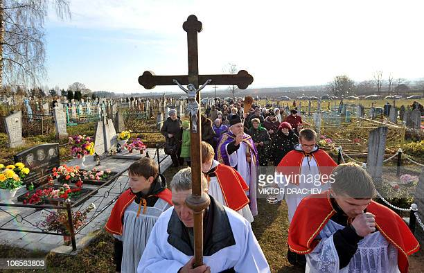 Catholic faithfuls take part in a religious procession at a cemetery near the Belarus village of Baruny some 105 km northwest of the capital Minsk on...