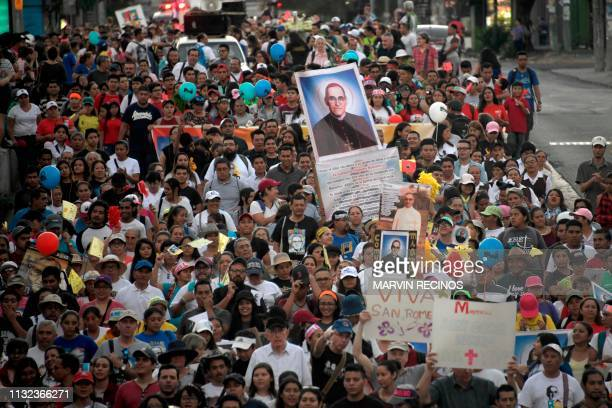 Catholic faithfuls take part in the Pilgrimage of the Light in San Salvador on March 23 2019 in commemoration of the martyrdom of Saint Oscar Arnulfo...