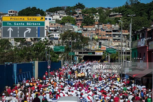 Catholic faithfuls take part in the procession from Sao Sebastiao dos Capuchinhos church to the Metropolitan Cathedral in Rio de Janeiro Brazil on...