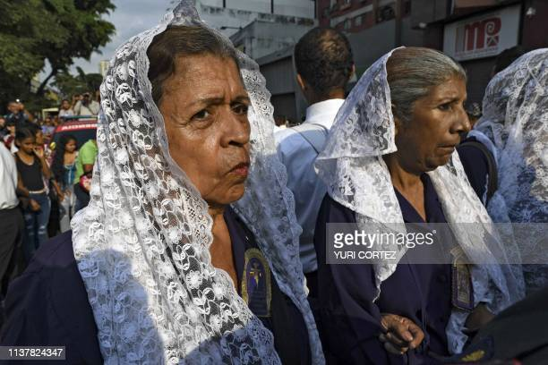 Catholic faithfuls take part in the traditional Nazareno de San Pablo procession in the framework of Holy Week celebrations in Caracas on April 17...