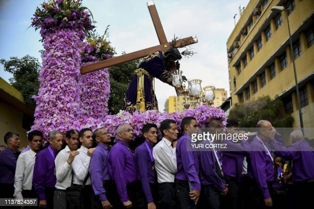 TOPSHOT Catholic faithfuls take part in the traditional Nazareno de San Pablo procession in the framework of Holy Week celebrations in Caracas on...