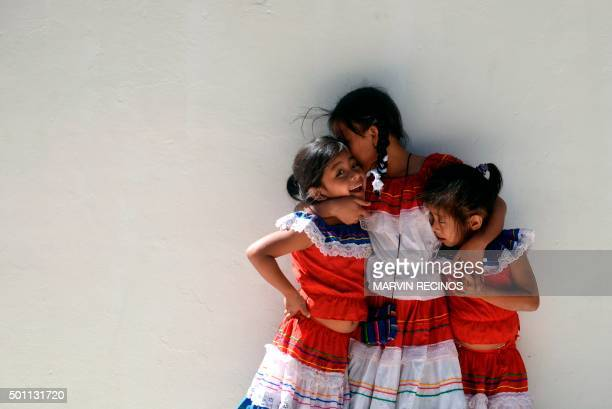 Catholic girls participate in a religious festivity in honor of the Virgin of Guadalupe at the Guadalupe Basilica in Antiguo Cuscatlan El Salvador on...