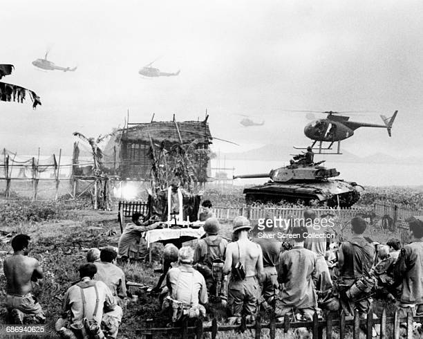 A Catholic mass takes place in a graveyard during the Vietnam War in a scene from the film 'Apocalypse Now' 1979