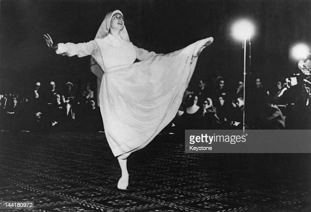 Catholic nun and former ballerina Sister Tina Bernal performs a 'prayer dance' at the national convention of the College Theology Society San...