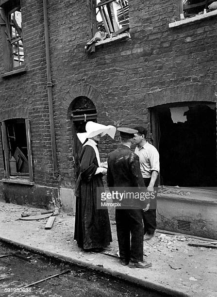 Catholic nuns from the order Sister of Mercy at scene of a V1 flying bomb incident in London August 1944 P009359
