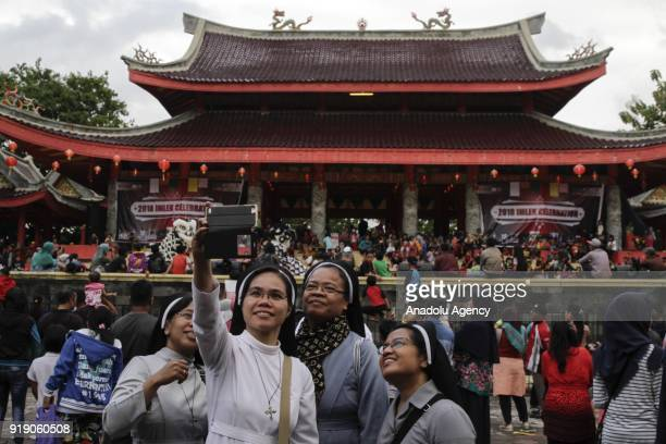 Catholic nuns pose for a selfie in front of the Sam Poo Kong temple in Semarang Central Java Indonesia on February 16 2018 The oldest temple in the...