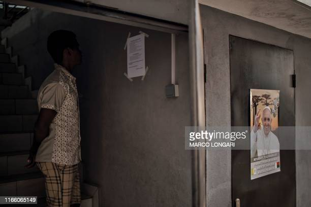 Catholic pilgrim reads a notice at the Saint Francois Xavier Antanimena Church in Antananarivo, on September 5 where he and several hundred others...