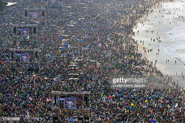 Catholic pilgrims attending World Youth Day crowd Copacabana beach in Rio de Janeiro on July 28 2013 waiting for the arrival of Pope Francis for the...