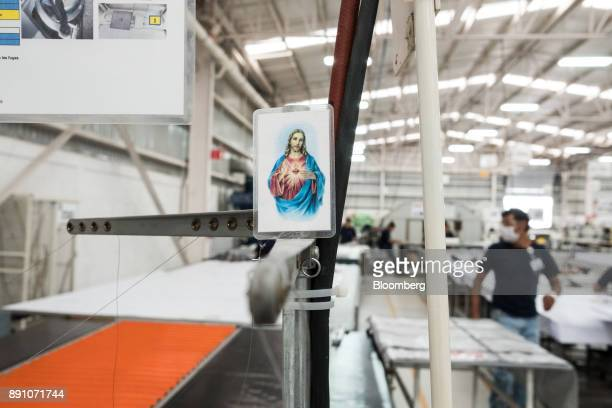 A catholic prayer card is seen at a workstation inside the Tighitco Inc manufacturing facility in San Luis Potosi Mexico on Thursday Nov 16 2017 With...
