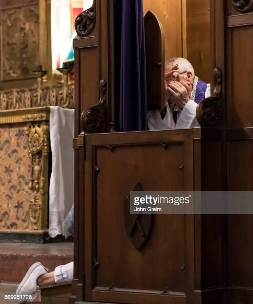 Catholic preiest hearing a confession