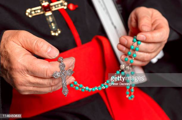 catholic priest / cardinal - rosary beads stock pictures, royalty-free photos & images