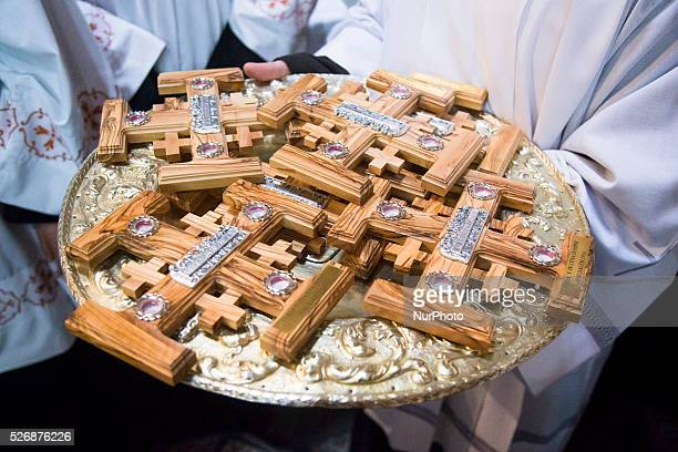 Catholic priest carries wooden crosses for Washing of the Feet ceremony during the celebration of the Holy Thursday mass the Church of the Holy...
