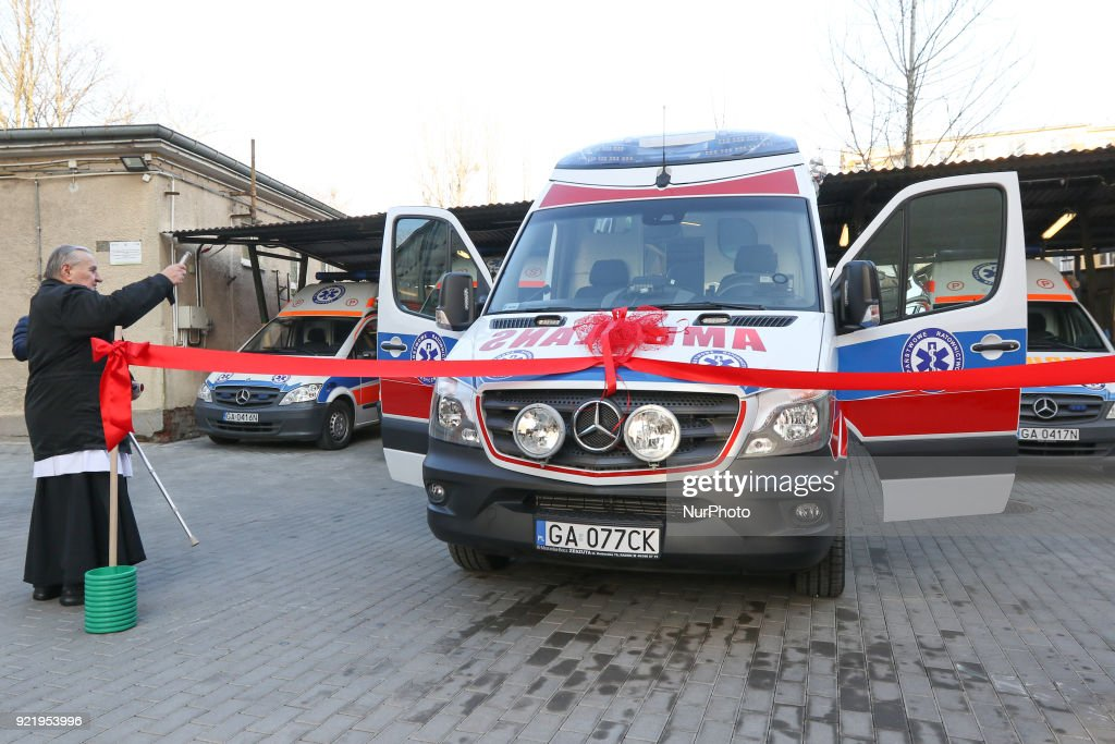 Catholic priest dedicating new Mercedes Sprinter ambulance outside the Gdynia Ambulance Station is seen in Gdynia, Poland on 21 February 2018 New Mercedes Sprinter ambulance costed over 100.000 Euro, and is 18th ambulance in the Gdynia Emergency Medical Services fleet.