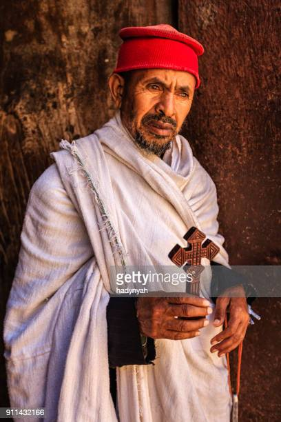 catholic priest from church of saint george, lalibela. ethiopia,africa - religious role stock photos and pictures