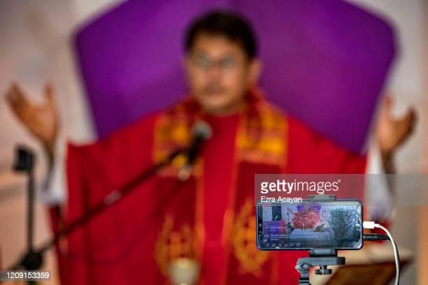Catholic priest holds Palm Sunday services through internet livestream on April 5 2020 in Quezon city Metro Manila Philippines Palm Sunday takes...