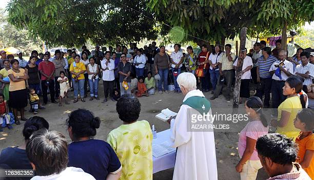 Catholic priest Ives Anderson officiates a mass at the camp set up by Bolivians from the country's low-lying Amazon basin inlands marching towards La...