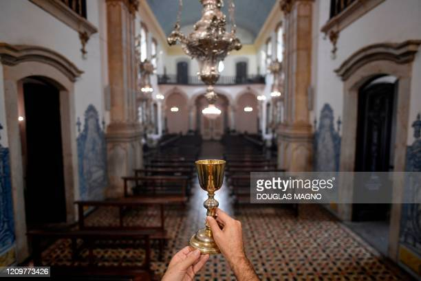 Catholic priest Marcelo Santiago celebrates Easter Sunday mass behind closed doors at Nossa Senhora do Carmo church after Holy Week celebrations were...