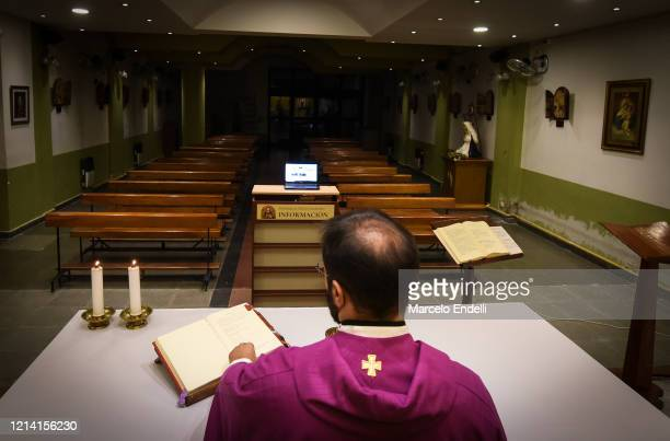 Catholic Priest Matías Barutta celebrates Sunday mass as it is broadcasted live via a YouTube channel at the church Cristo Maestro on March 22, 2020...