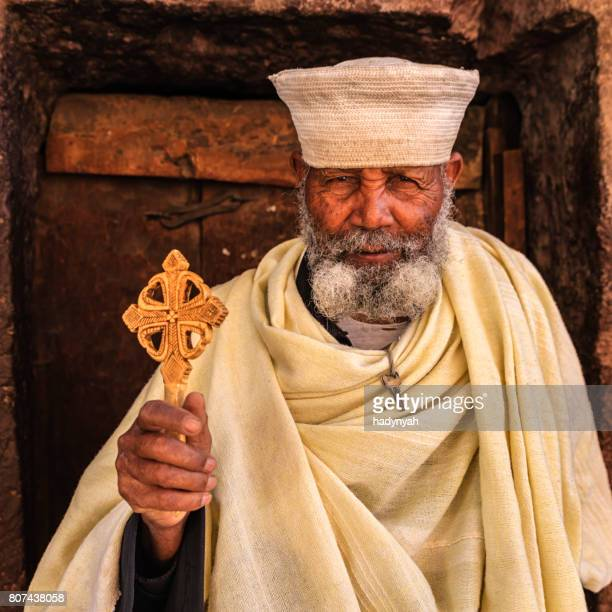 catholic priest of rock-hewn churches of lalibela. ethiopia,east africa - religious occupation stock pictures, royalty-free photos & images