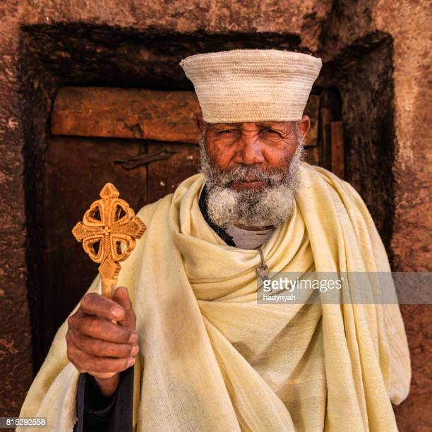 catholic priest of rock-hewn churches of lalibela. ethiopia,east africa - lalibela stock photos and pictures