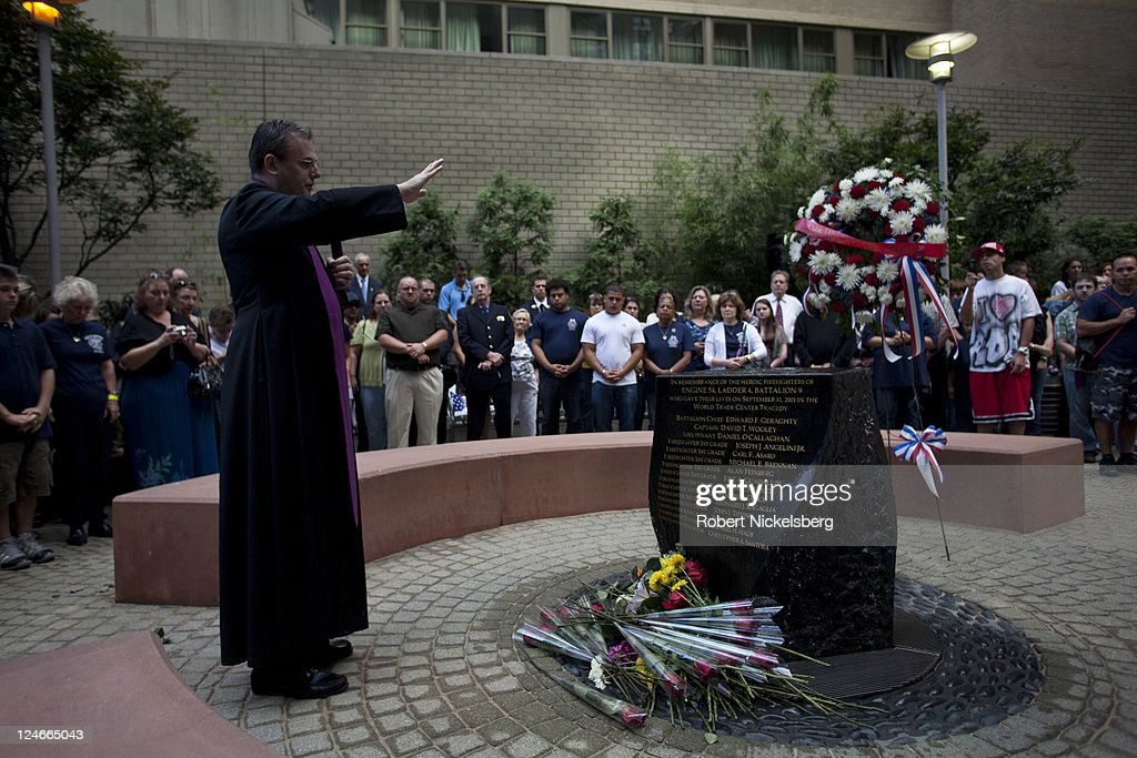 A Catholic priest offers a convocation during the tenth anniversary service honoring the Fire Department of New York (FDNY) West 48th Street firehouse's 15 firefighters who died responding to the September 11, 2001 terrorist attacks at the World Trade Center September 11, 2011 in New York City. 343 FDNY firefighters perished when they responded to the 9-11 WTC attacks. New York City and the nation are commemorating the tenth anniversary of the terrorist attacks which resulted in the deaths of nearly 3,000 people after two hijacked planes crashed into the World Trade Center, one into the Pentagon in Arlington, Virginia and one crash landed in Shanksville, Pennsylvania.