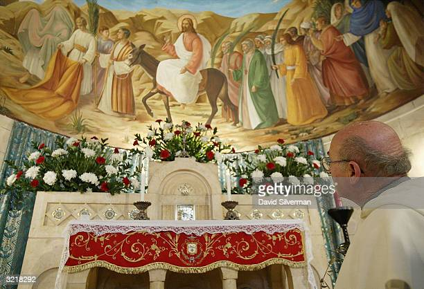 Catholic priest prays in the chapel of Beth Page on the Mt of Olives the starting place of the annual Palm Sunday procession into the holy city on...