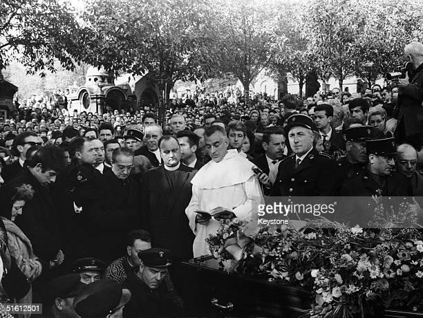 A catholic priest says a prayer by the coffin of French singer Edith Piaf during her funeral at the Pere Lachaise cemetery Paris 14th October 1963...