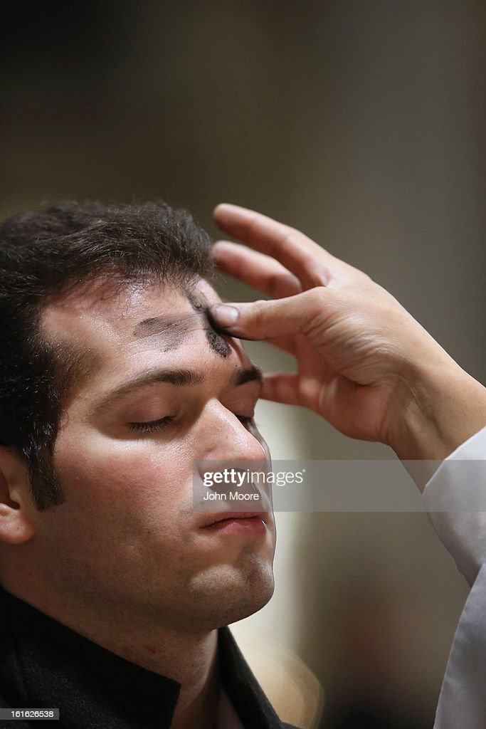 A Catholic receives ashes on his forehead while celebrating Ash Wednesday at St. Patrick's Cathedral on February 13, 2013 in New York City. Ash Wednesday marks the beginning of Lent, a 40-day period of pray and fasting for many Christians.