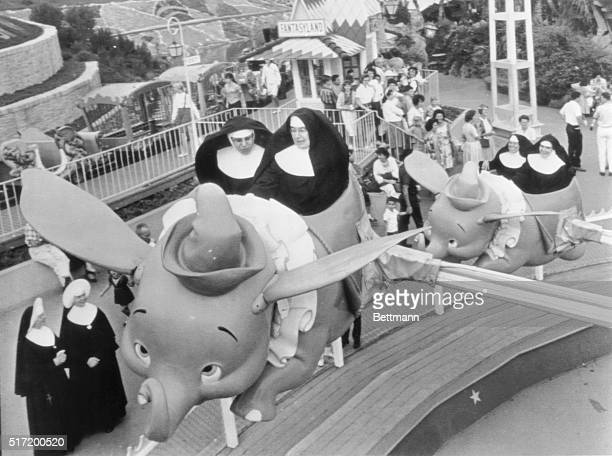 Catholic School Day at Disneyland and Sisters Mary William and Mary Alfred take the first elephant as Sisters Mary Yvonne and Mary Joachin follow...