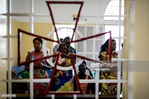 Catholic Sudanese people pray for the peace during the religious ceremony in Juba South Sudan on February 23 2014 Due to the conflict between...