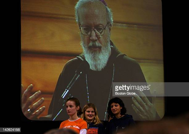 Catholic teens listen to Bishop Sean O'Malley as his image is projected on a screen during the Archdiocese of Boston Catholic Youth Rally held at...