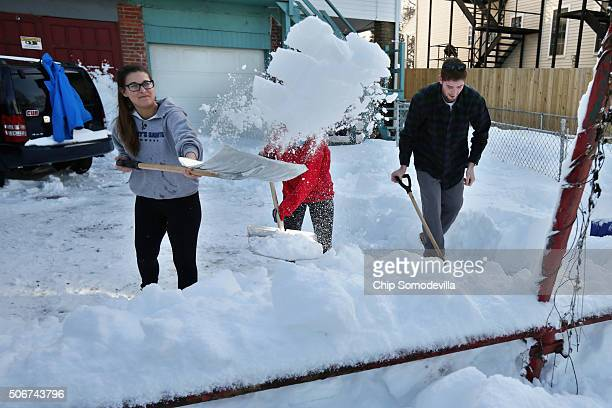 Catholic Unveristy students shovel the parking lot behind their house after Winter Storm Jonas covered the region with more than two feet of snow...