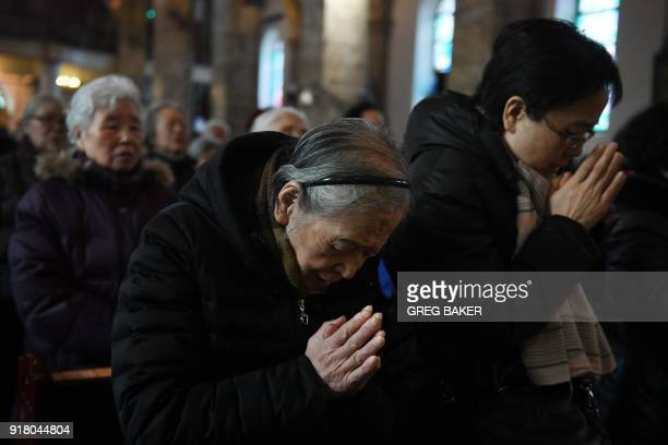 Catholic worshippers attend a mass on Ash Wednesday which marks the beginning of Lent at Beijing's government sanctioned South Cathedral on February...