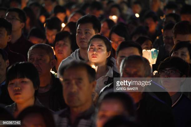Catholic worshippers attend a mass on Holy Saturday part of Easter celebrations at Beijing's government sanctioned South Cathedral on March 31 2018...