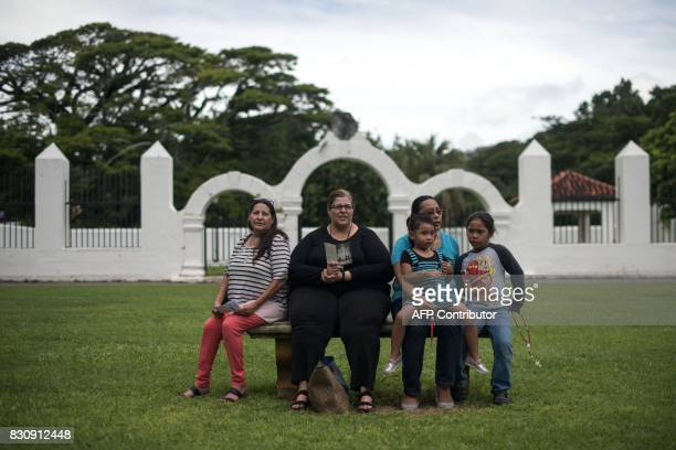 Catholic worshippers attend a prayers for peace rally marking the 100th anniversary of Our Lady of Fatima in Hagatna on August 13 2017 The Catholic...