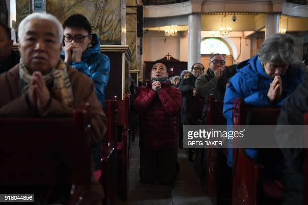 Catholic worshippers attend an Ash Wednesday mass which marks the beginning of Lent at Beijing's government sanctioned South Cathedral on February 14...