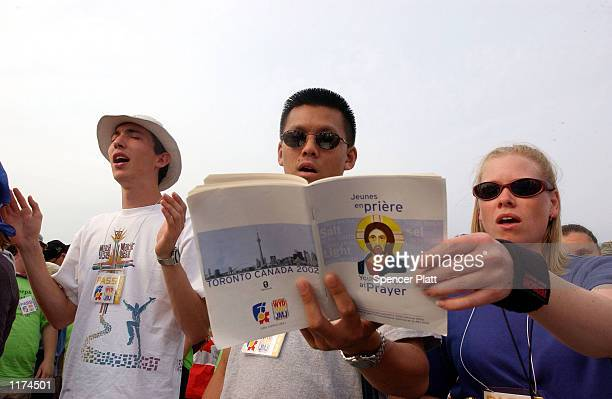 Catholic youths referred to as pilgrims pray while listening to Pope John Paul II speak during a welcoming ceremony part of the 17th World Youth Day...