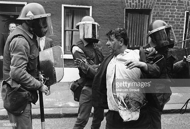 5 Catholics are killed 60 injured and hundreds of homes devastated when the British Army impose a curfew in the Falls Road Belfast 3rd July 1970