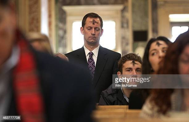 Catholics attend Ash Wednesday Mass at the Cathedral of St. Matthew the Apostle February 18, 2015 in Washington, DC. On Ash Wednesday, Catholics...